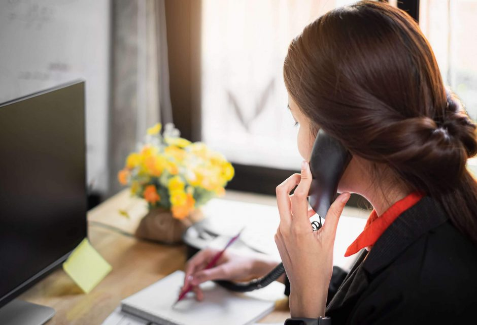 business-woman-note-schedule-book-talking-with-customer-by-telephone-1-scaled.jpg
